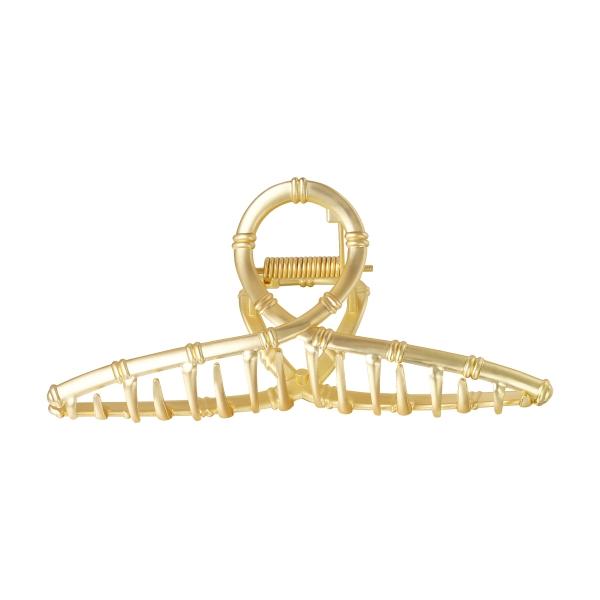 Große metallhaarspange in goldfarbe mit akzenten aus kunstbambus