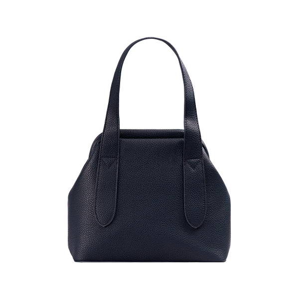 PU leather bag with fabric covered closure